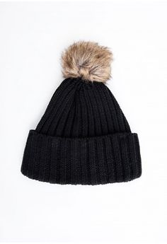 Keep warm in style this season with this luxe black beanie hat featuring cute faux fur brown pom pom detail.  One size fits all