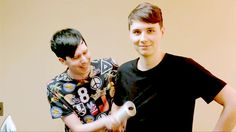 here we see the stalker, dan howell, holding phil lester hostage and making him lint roll his clothes. so sad :( #pray4phil