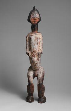 Male Reliquary Figure, 19th century Gabon or Democratic Republic of Congo; Ambete Wood, pigment, metal, cowrie shells