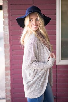 This ivory colored cardigan is lush and soft for ultimate comfort and style. It is easy to layer over a casual tee or with your favorite dress and tights.