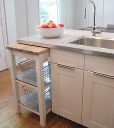 Function in every budget. This Ikea kitchen makes room for expanding counters!