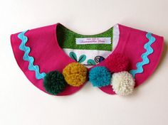 Oh what fun! Vibrant and slightly Frida-esque pom pom collar. Easy to wear and definitely designed to be noticed. Fully lined with a velcro tab to