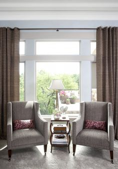 pair of chairs & small table in front of large window - general idea but swivels and color changes.