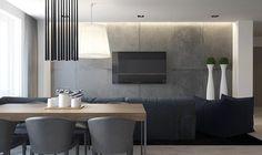 intérieur à aire ouverte aménagé avec un canapé gris graphite, un mur en béton, une table à manger en bois clair et des chaises grises
