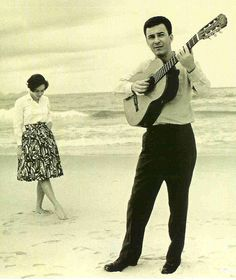 João Gilberto with wife and fellow musician Astrud Gilberto on the beach