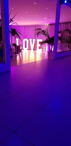 Wedding planners #simplymediterraneanweddings.co.uk Love Letters #illuminography Lighting #recital  Venue #Le Ciel Santorini