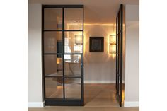 Stalen deuren van FritzJurgens, staal en glas tot aan de plafond