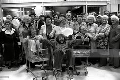 22nd, May, 1979, Blackpool, England, Fine-Fare supermarket opening, Sitting left to right in supermarket trolleys are: Tim-Brooke-Taylor, Bill Oddie, and Graeme Garden, alias the 'Goodies', stars of the popular 70's television programme with members of the public
