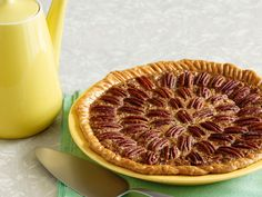Southern Pecan Pie : For a decorative pie topping, Guy reserves a cup of pecan halves to place over the filling in a pattern before baking.