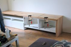Materials: 2 besta cabinets and a big slab of oak  Description: We wanted a multi purpose cabinet that would fit our small living. The room is narrow an