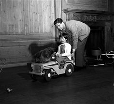 England, King Michael of Romania is pictured pushing his eldest daughter Princess Margaret and their pet dog in a toy car Michael I Of Romania, Romanian Royal Family, Elisabeth I, Grand Duchess Olga, Old King, Central And Eastern Europe, Puppy Training Tips, Princess Margaret, Film Quotes