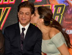 Shah Rukh Khan being kissed by Deepika Padukone at launch of Sharabi song from 'Happy New Year'.