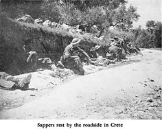 black and white photograph of resting soldiers