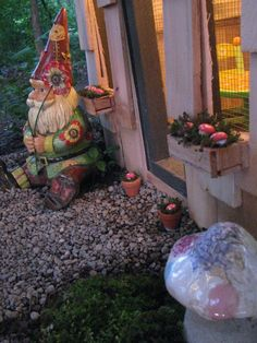 Toadstools are made from wooden knobs that I painted.  Christmas lights on a timer light the gnome house.