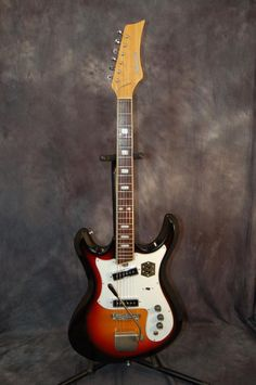 Silvertone by Teisco Model 1445 Double Pickup Mosrite Styling Original Hardshell Case 1969 Sunburst   Reverb.com. Give us a call. Lawman Guitars. 515-864-6136