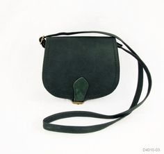 "Cross Body Saddle Bag (Purse / Handbag in Multiple Colors) Compact saddle bag style handbag with buckle closure. Approximately 8.5"" w x 7.5"" h x 3"" d; strap adjusts from 28-54"" long. The body is faux leather with real suede trim."