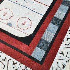 I made this quilt for a grandson who loves hockey. The center is a hockey rink panel.
