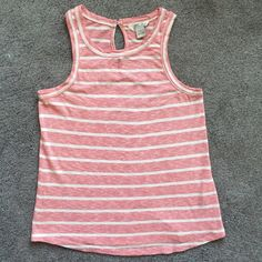 Lucky Brand Striped Cotton Tank All over striped design -Back button-tab closure with keyhole cutout - Sleeveless design -Curved hemline -100% cotton -Machine wash cold, tumble dry low Measurements: Length - 25 in -Never worn SKU#8392007 Lucky Brand Tops Tank Tops