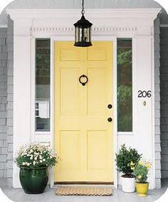 yellow front door heralds spring and summer
