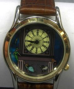 Rare Peter Pan watch depicting Tinkerbell, Peter, Wendy, John and Michael flying at the bottom under a large clock tower.