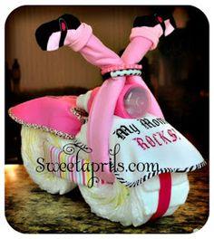 A cute alternative to the layer diaper cake idea.