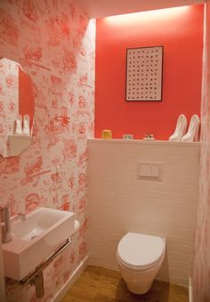 Ditmas Park rose-pink bath with wall-mount toilet and sink.