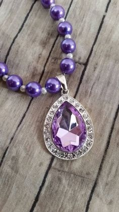 Check out this item in my Etsy shop https://www.etsy.com/listing/220286424/sofia-the-first-inspired-purple-amulet