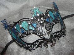 Shades of Turquoise and Black Metallic by TheCraftyChemist07.