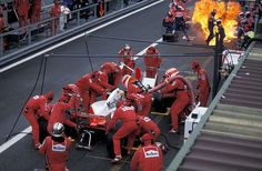 """"""" Scary sight in Spa-Francorchamps in 1995: Mark Blundell pits his McLaren as Eddie Irvine's car catches fire during his stop """""""