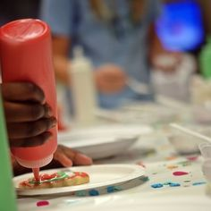 Put frosting in condiment containers for kids to decorate cookies- great idea!