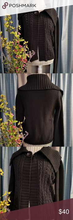 🌻🌺🌻CALVIN KLEIN BELL SLEEVE KNIT SWEATER!! SIZE:large   BRAND:Calvin Klein   CONDITION:like new, no flaws    COLOR:black  Beautiful collar and bell sleeves on this sweater. Has c hook underneath wooden button at the top.   🌟POSH AMBASSADOR, BUY WITH CONFIDENCE!   🌟CHECK OUT MY OTHER ITEMS TO BUNDLE AND SAVE ON SHIPPING!   🌟OFFERS WELCOME!   🌟FAST SHIPPING! Calvin Klein Sweaters