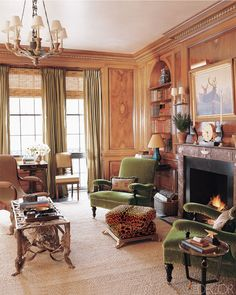 Cozy living room with plush leopard cushions and crackling fire!