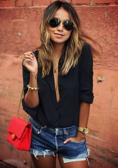denim shorts from Levis, black round collar shirt from Everlane and a red vintage bag from Chanel