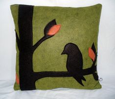 Just what is this little birdie thinking? This modern silhouette design is a stylish pick-me-up in any room that you place it in. Wool felted, handmade pillow with birds and tree motif.  #pillows #bird #woolpillow #handmadepillow #naturedecor #interiordesign #contemporary    https://happyhivecreative.com/product/green-wool-felt-pillow-bird-pillow/