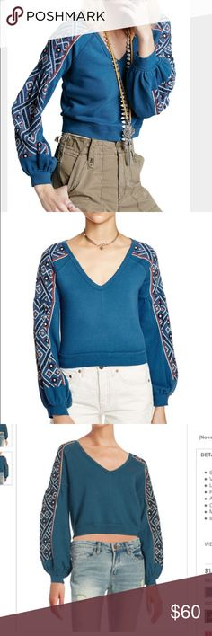 Free People NWT cropped knit Soak up the Spanish influence of Free People's Senorita sweatshirt, bedecked with bold embroidery and cut with dramatic poet sleeves for exotic edge. Free People Tops Crop Tops