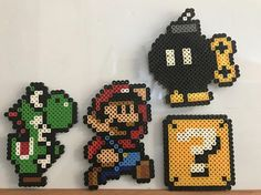 Mario, Yoshi , inventory and all other characters Mario fan should love, home made with Perler beads. Its magnetic. Available to sell individually or customized with different characters. White board size 21.5 x 15 Mario 3x5