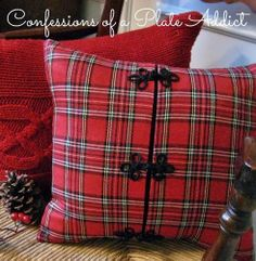 Love this Tartan pillow made by Debbie at 'Confessions of a Plate Addict!' She repurposed a red sweater and a child's tartan dress and came up with two fabulous pillows!