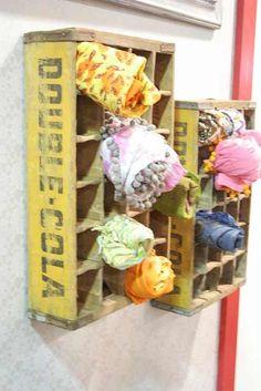 Display scarfs in old pop bottles crates.