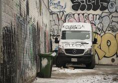 Graffiti covers a Chinatown alleyway (Toronto, Ontario)