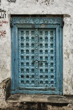 Blue door, Stone Town, Zanzibar by neildakeyne, via Flickr