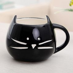 Enjoy your morning brew (tea or coffee) in this adorable ceramic cat mug available in black and white. Dishwasher safe.
