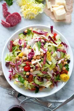 A bright, bold, Italian-style salad featuring your favorite olives an antipasti, crisp veggies, cured Genoa salami, provolone cheese and a homemade Italian vinaigrette. This colorful recipe is a great way to begin a meal or enjoy on its own