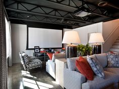 Looking for Living Space and Media Room ideas? Browse Living Space and Media Room images for decor, layout, furniture, and storage inspiration from HGTV. Basement Living Rooms, Game Room Basement, Modern Basement, Basement Ideas, Basement Designs, Kids Basement, Basement Ceilings, Basement Inspiration, Basement Bars