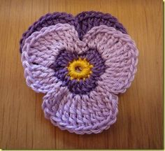 This crochet pansy flower is a pretty embellishment for girls garment or accessories. And it's an easy project for crochet beginners to try. Let's see the