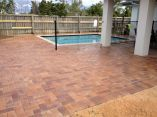 Claypave brick paving around pool colour level with coping