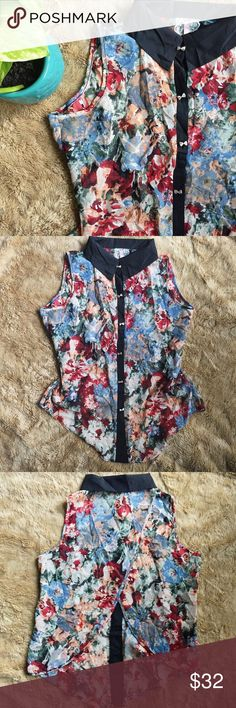 Anthropologie Floral Collared Blouse Perfect condition. Worn very lightly.  Bold and beautiful sleeveless button down top by Maeve. Beautiful floral pattern with so many complimenting colors. Lots of deep red, coral, forest green, light sky blue, cream.. it reminds me of a beautiful watercolor painting. Bold black color and along the trim of the buttons, which in turn brings out the adorable silver bow - shaped buttons. Open slit in the back.  Not sold in stores anymore and hard to find…