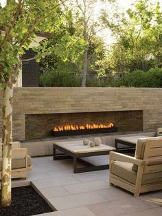 Really like this. We like the look of the patio material. Fireplace is great but too big. Don't want gas.