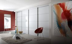 Shown with a matt aluminium frame, these pure white glass sliding wardrobes add a  fresh, cool look to any scheme.