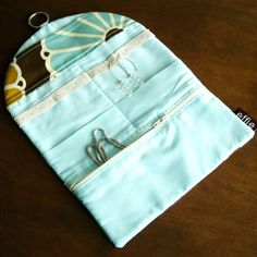 Travel Jewelry Roll Organizer. I like that it has a way to hang earrings.