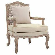 "With French design influences and expertly hand-carved detailing, this teak-framed arm chair brims with sophisticated style.   Product: ChairConstruction Material: Wood and fabricColor: BleachFeatures: Hand-carvedDimensions: 38"" H x 28"" W x 28"" D"
